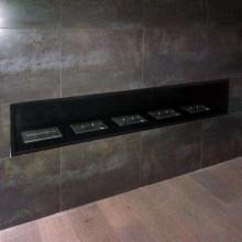 Foyer 5 rampes M, intégré dans mur Corten (aspect rouillé)
